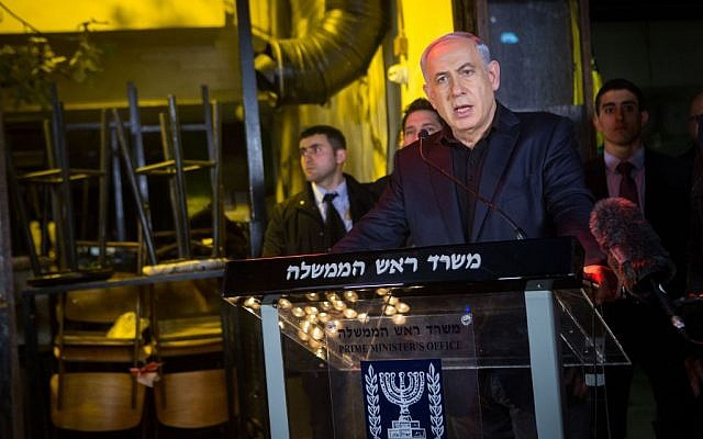 Prime Minister Benjamin Netanyahu at the scene of the January 1 shooting attack in Tel Aviv on January 2, 2016. (Miriam Alster/Flash90)