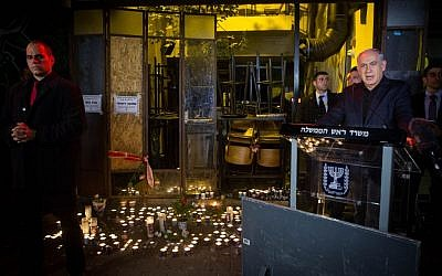 Prime Minister Benjamin Netanyahu speaks to the press after lighting a candle outside a pub on Dizengoff Street , the scene of deadly shooting attack, Tel Aviv, January 2, 2016. (Miriam Alster/Flash90)