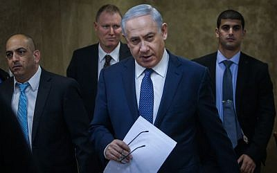 Prime Minister Benjamin Netanyahu on his way to the cabinet meeting in Jerusalem on January 3, 2016. (Alex Kolomoisky/Pool)
