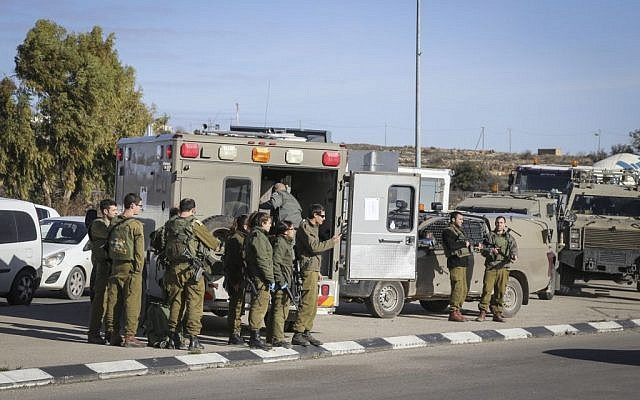 File: Israeli security forces at the scene of a stabbing attack at the Gush Etzion Junction, January 5, 2016. (Gershon Elinson)