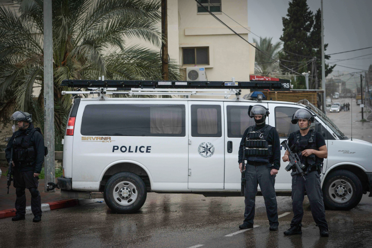 Israeli security forces blocking a road in the Israeli Arab village of Arara, Northen Israel on January 8, 2016, as Nashat Milhem is tracked down. (Basel Awidat/Flash90)