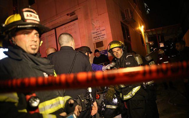 Firefighters work to extinguish a blaze at the Jerusalem offices of left-wing NGO B'Tselem, on January 10, 2016. (Yonatan Sindel/Flash90)
