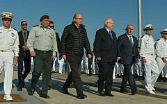 IDF Chief of Staff Gadi Eisenkott, then defense minister Moshe Ya'alon, President Reuven Rivlin and Prime Minister Benjamin Netanyahu at a welcoming ceremony for the new submarine 'Rahav' at the Israeli navy base in Haifa, on January 12, 2016. (Kobi Gideon/GPO)