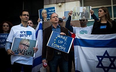 Yisrael Beytenu MK Oded Forer seen with party supporters outside the Swedish Embassy in Tel Aviv, on January 15, 2016. (Miriam Alster/Flash90)