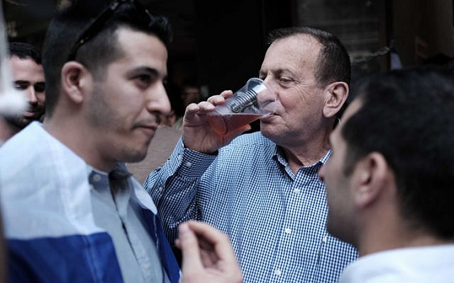 Tel Aviv Mayor Ron Huldai attends a street party on January 15, 2016 at the Simta bar on Dizengoff Street, where two weeks ago two Israelis were killed in a shooting attack. (Photo by Tomer Neuberg/FLASH90)