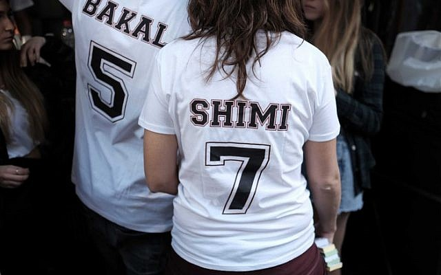 Patrons wear t-shirts bearing the names of the two Israelis killed two weeks ago in a shooting attack at the Simta bar in Tel Aviv, as they attend a street party in support of the pub on January 15, 2016. (Photo by Tomer Neuberg/FLASH90)