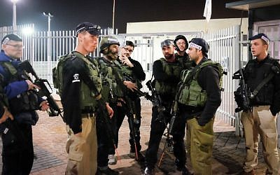 Residents and civilian security personnel of the Jewish community of Efrat take part in a night-time drill against terror attacks in the West Bank settlement on January 20, 2015. (Gershon Elinson/FLASH90)