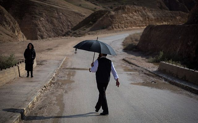 An Ultra Orthodox Jewish man seen visiting Wadi Og, in the Judean Desert, south of Jerusalem, on January 24, 2016. Many Israelis come to see the flooding of the river after heavy rains. (Hadas Parush/Flash90)