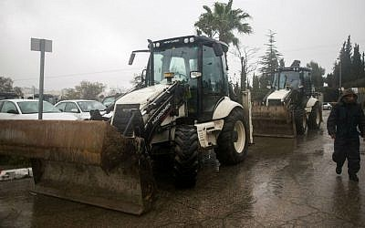 The Jerusalem Municipality prepares tractors for clearing the snow which is expected to fall in Jerusalem this week, January 24, 2016. (Yonatan Sindel/Flash90)