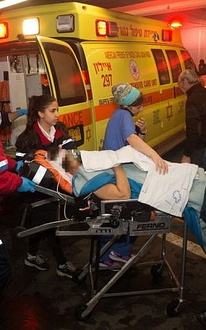 Medics wheel a wounded Israeli woman into the emergency room of the Shaare Zedek Medical Center on January 25, 2016. She was one of two Israeli women injured in a stabbing attack at the entrance to Beit Horon, in the West Bank. (Yonatan Sindel/Flash90)