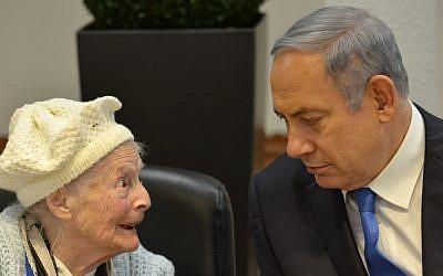 Prime Minister Benjamin Netanyahu meets with Holocaust survivors ahead of International Holocaust Remembrance Day. January 26, 2016 (Kobi Gideon/GPO/Flash90)