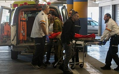 An Israeli man wounded in a shooting attack in the West Bank is wheeled into the emergency room at Shaare Zedek Medical Center in Jerusalem on Sunday, January 31, 2016 (Yonatan Sindel/Flash90)