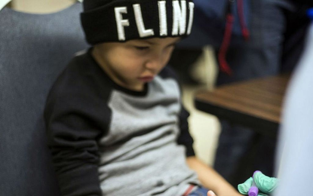 Grayling Stefek, 5, has his blood drawn during a free lead testing event and family fun night for children on Tuesday, January 26, 2016, at Eisenhower Elementary school in Flint, Michigan. (Conor Ralph/The Flint Journal-MLive.com via AP)
