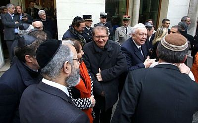 Jewish leaders gather outside a Marseille synagogue during a visit from French Interior Minister Bernard Cazeneuve, January 14, 2016. (AP/Claude Paris)