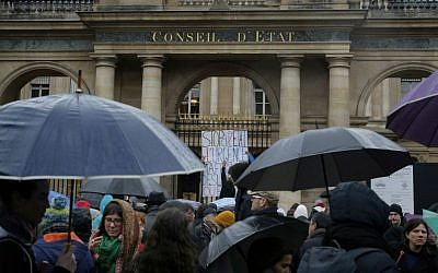 Protesters outside France's top administrative court, in Paris, Saturday, Jan. 30, 2016. (AP Photo/Christophe Ena)