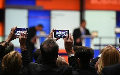 People take photos of the candidates during the Fox Business Network Republican presidential debate in North Charleston, South Carolina, on January 14, 2016. (AP/Rainier Ehrhardt)