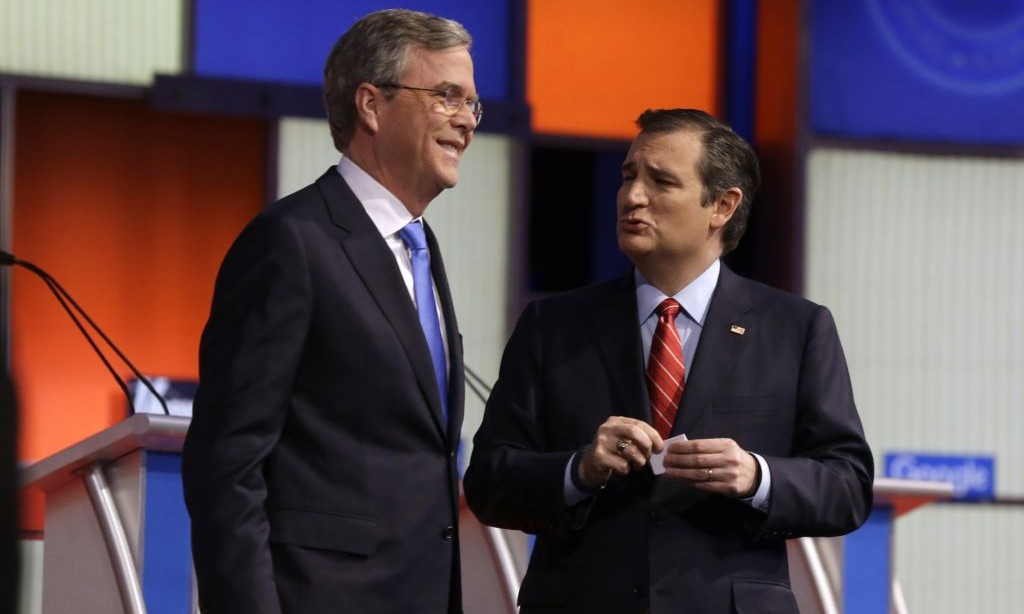 Ted Cruz, right, talks to Jeb Bush after a Republican presidential primary debate, Thursday, Jan. 28, 2016, in Des Moines, Iowa. (AP Photo/Chris Carlson)
