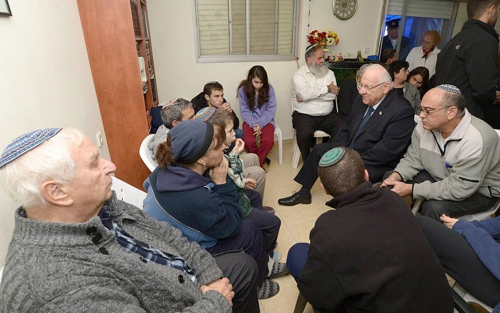 President Reuven Rivlin visits the Krigman home to pay his condolences to the family after their 23-year-old daughter Shlomit is stabbed to death in a terror attack (Mark Neyman / GPO)