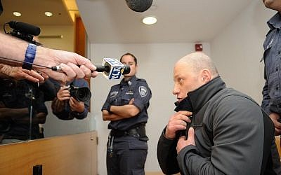 Gennady Galkin arrives to a court hearing at the Haifa Magistrates Court Janaury 20, 2016, Gelkin was arrested in Berlin on Wednesday after being a suspect of murdering Edward Rothberg, 25, at a club in Haifa in 1998. Photo by Basel Awidat/Flash90.  ??? ????