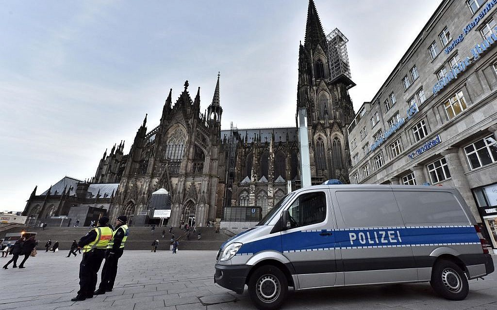 Police patrol in front of the main train station and the cathedral in Cologne, Germany, Monday, January 18, 2016. (AP Photo/Martin Meissner)