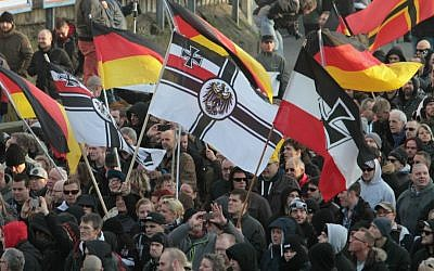Right-wing demonstrators march in Cologne, Germany, Saturday, Jan. 9, 2016. (AP Photo/Juergen Schwarz)