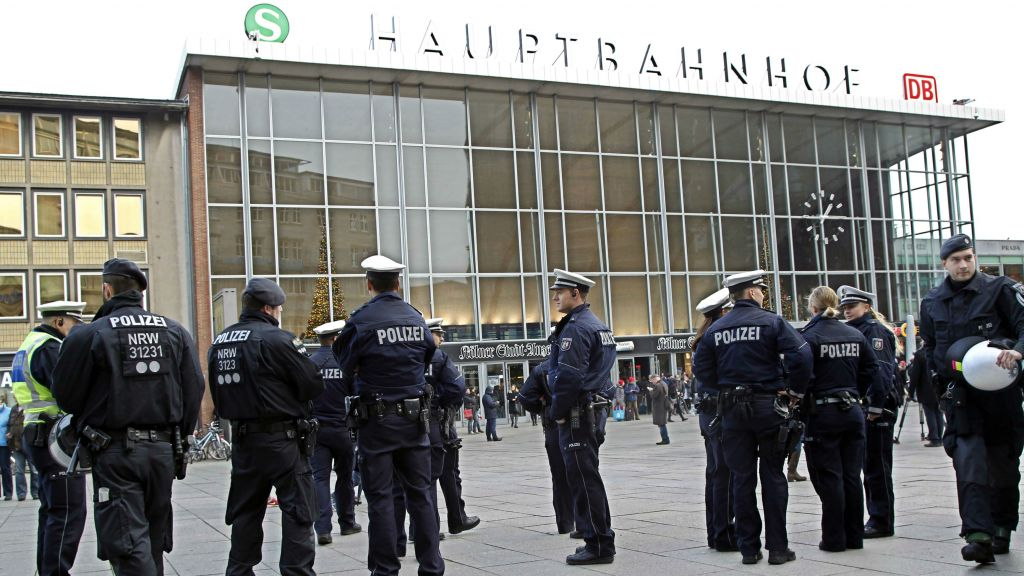 Police officers patrol in front of the main station of Cologne, Germany, on Wednesday, Jan. 6, 2016. (AP Photo/Hermann J. Knippertz)
