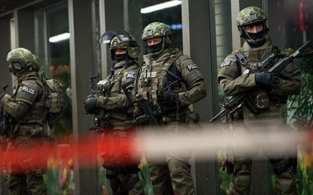 German special police stand in front of the main train station in Munich, southern Germany, on New Year's Eve, December 31, 2015. (Sven Hoppe/dpa via AP)