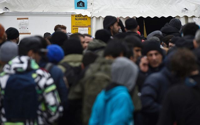 Migrants queue up next to a tent at the State Office of Health and Social Affairs (LAGeSo) in Berlin on January 27, 2016. (TOBIAS SCHWARZ/AFP/Getty Images)