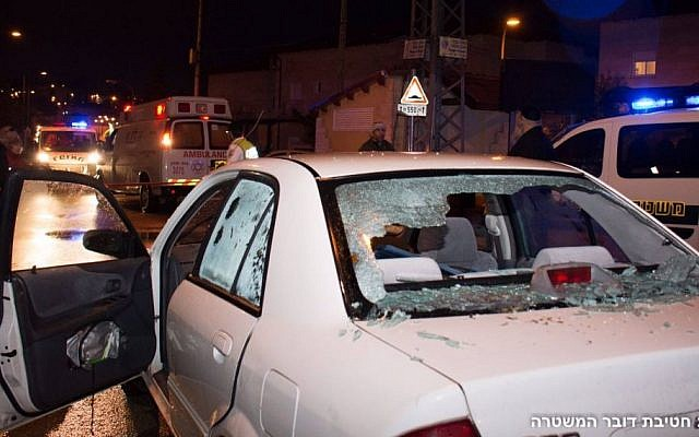 A car with its windshield shattered by bullets, at the scene of a terror attack in which two people were wounded by two Palestinian stabbers, in the West Bank settlement of Beit Horon on Monday, January 25 2016 .(Israel Police)