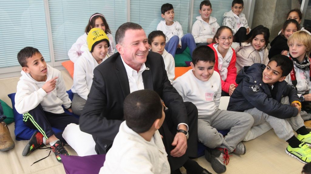 Knesset Speaker Yuli Edelstein sits with children visiting the Knesset on Tuesday, January 18 2016, the 50th anniversary of the Knesset building in Jerusalem. (Knesset)