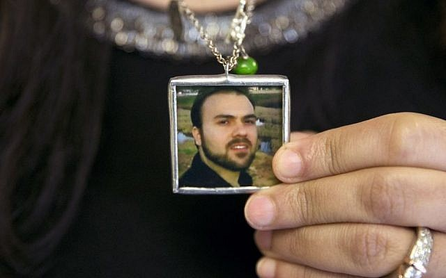 Naghmeh Abedini holds a necklace with a photograph of her husband, Saeed Abedini, on Capitol Hill in Washington, June 2, 2015 (AP Photo/Jacquelyn Martin, File)