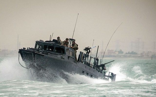 In this Oct. 30, 2015, photo provided by the US Navy, Riverine Command Boat (RCB) 805, along with its crew members, is shown transiting through rough seas during patrol operations in the Persian Gulf. (Torrey W. Lee/US Navy via AP)