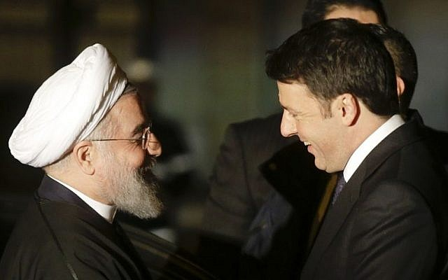 Iranian President Hassan Rouhani shakes hands with Italian Premier Matteo Renzi during their meeting at the Campidoglio, Capitol Hill, in Rome, Monday, January 25, 2016. (AP Photo/Gregorio Borgia)