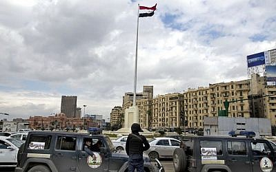 Egyptian police stand guard a day ahead of the fifth anniversary of the Jan. 25, 2011 uprising in Tahrir Square, Cairo, Egypt on Jan. 24, 2016. (AP Photo/Roger Anis)