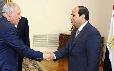 In this Wednesday, May 20, 2015 file picture provided by the office of the Egyptian Presidency, Egyptian President Abdel-Fattah el-Sissi, right, shakes hands with newly-appointed Justice Minister Ahmed el-Zind during a swearing-in ceremony in Cairo, Egypt. (Egyptian Presidency via AP)