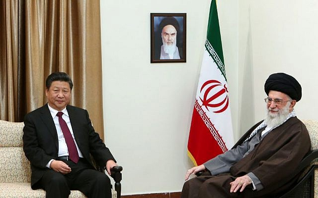 In this photo from January 23, 2016, released by an official website of the office of the Iranian supreme leader, Supreme Leader Ayatollah Ali Khamenei, right, meets with Chinese President Xi Jinping in Tehran, Iran. A portrait of late Iranian revolutionary founder Ayatollah Khomeini hangs on the wall. (Office of the Iranian Supreme Leader via AP)