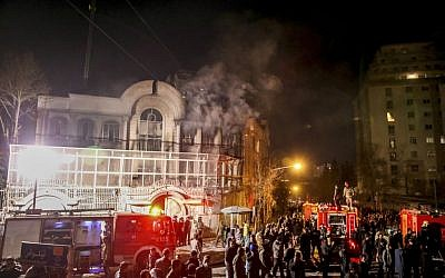 Smoke rises as Iranian protesters upset over the execution of a Shiite cleric in Saudi Arabia set fire to the Saudi embassy in Tehran, Sunday, January 3, 2016. (Mohammadreza Nadimi/ISNA via AP)