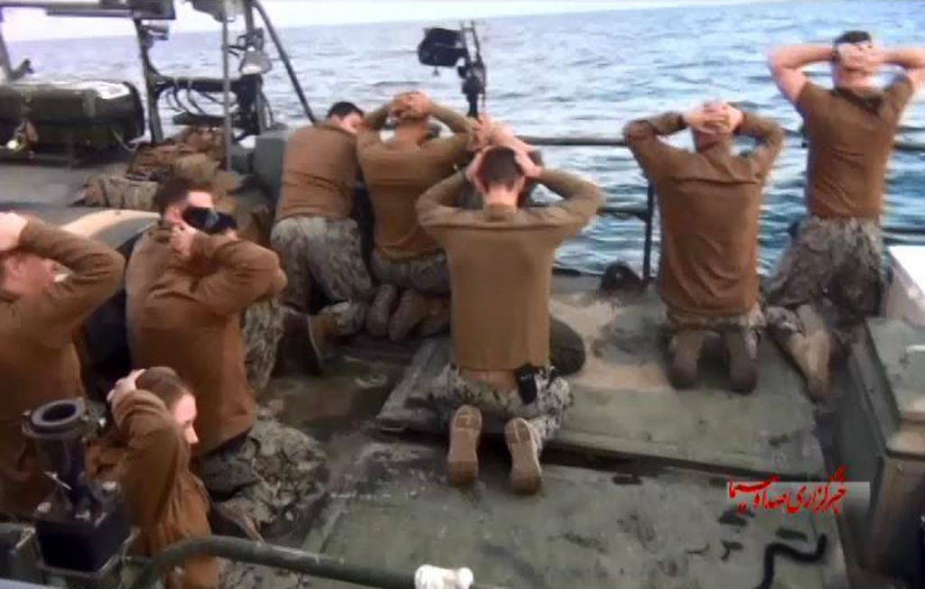 This photo released by the Iranian state-run IRIB News Agency on Wednesday, January 13, 2016, shows detention of American Navy sailors by the Iranian Revolutionary Guards in the Persian Gulf, Iran. (Sepahnews via AP)