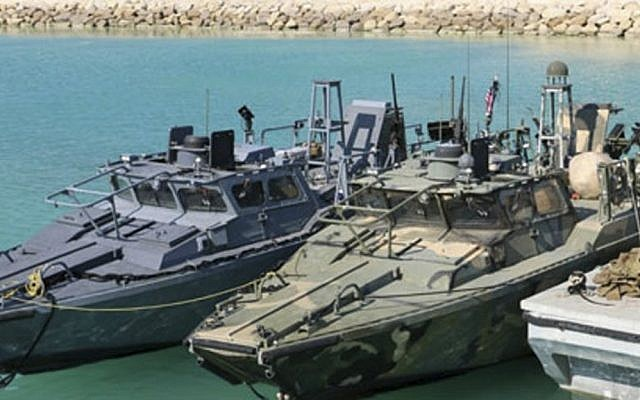 This picture released by the Iranian Revolutionary Guards on Wednesday, Jan. 13, 2016, shows detained US Navy sailors' boats in custody of the guards in the Persian Gulf. (Sepahnews via AP)