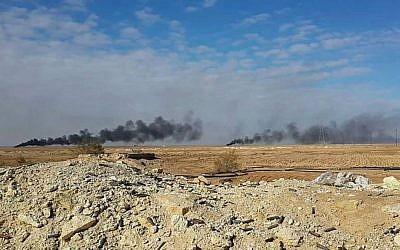 Smoke rises following a US-led coalition airstrike on Islamic State group positions, outside Haditha, Iraq, on January 5, 2016. (AP)