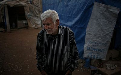 Ibrahim Mahmoud standing in Baharka refugee camp in Iraq's northern Kurdish region after fleeing Islamic State militants, January 11, 2016. (AP Photo/Bram Janssen)