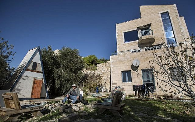 Illustrative: In this photo taken Sunday, Jan. 17, 2016, Moshe Gordon sits outside his guest house advertised on Airbnb international home-sharing site in Nofei Prat settlement at the West Bank. (AP Photo/Tsafrir Abayov)