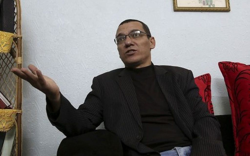 Palestinian journalist Ayman al-Aloul, 44, talks during an interview with the Associated Press on January 12, 2016. (AP/Adel Hana)
