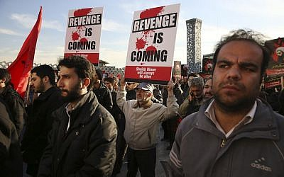 Iranian demonstrators hold anti-Saudi placards in a rally to protest the execution by Saudi Arabia last week of Sheikh Nimr al-Nimr, a prominent opposition Saudi Shiite cleric, in Tehran, Iran, January 4, 2016. (AP/Vahid Salemi)