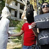 Illustrative: In this photo from April 1, 2010, activists from a civil organization reenact an execution scene in front of the Saudi Arabia Embassy in Beirut, Lebanon, as they protest a possible beheading of a Lebanese man accused of witchcraft in Saudi Arabia. (AP/Bilal Hussein, File)