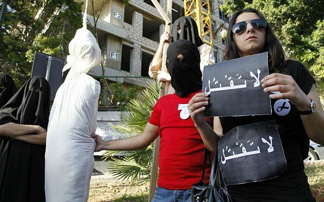 File: In this Thursday, April 1, 2010 file photo, activists from a civil organization reenact an execution scene in front of the Saudi Arabia Embassy in Beirut, Lebanon, as they protest a possible beheading of a Lebanese man accused of witchcraft in Saudi Arabia. (AP/Bilal Hussein, File)