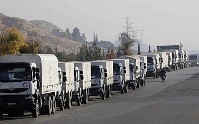 A convoy of trucks loaded with humanitarian supplies are seen heading to the besieged town of Madaya, some 24 kilometers in southwest Damascus, Syria, on Thursday, January 14, 2016 (AP Photo)