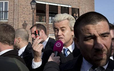"Firebrand Dutch lawmaker Geert Wilders talks to a TV reporters as he hands out ""self-defense sprays"" to women fearful of being attacked by migrants, in the center of Spijkenisse, near Rotterdam, Netherlands, Saturday, Jan. 23, 2016. (AP Photo/Peter Dejong)"