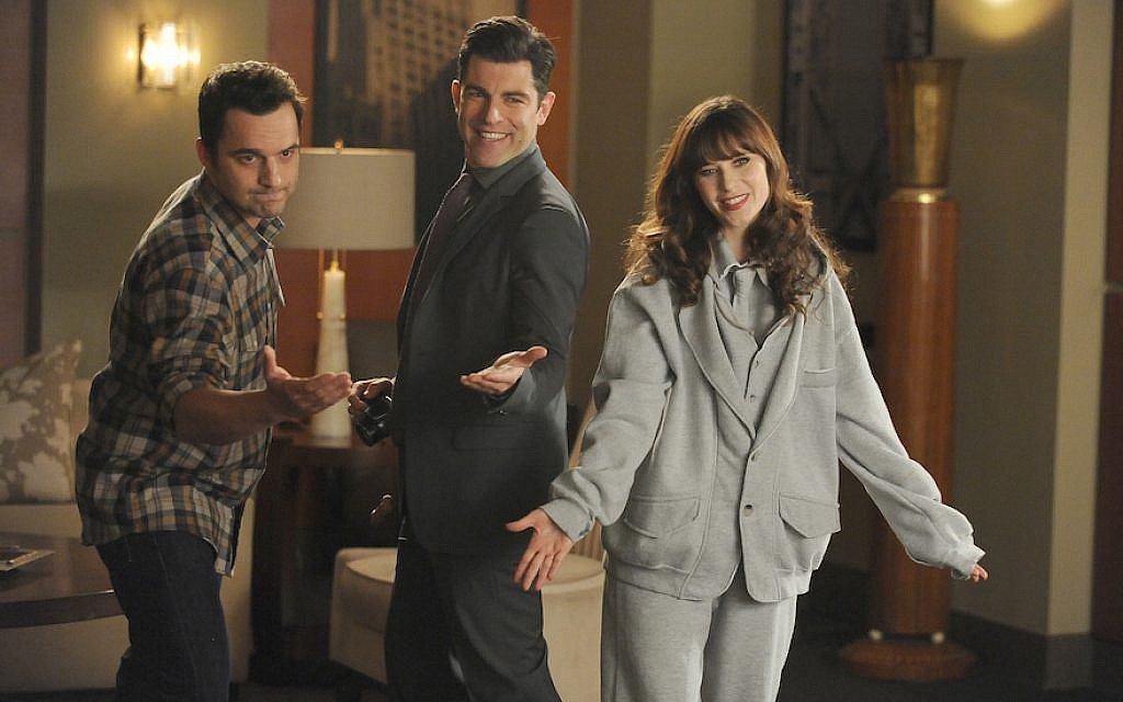 """Schmidt (Max Greenfield), center, Nick (Jake Johnson), left, and Jess (Zooey Deschanel) in a scene from """"New Girl,"""" Feb. 3, 2015. (FOX via Getty Images / JTA)"""