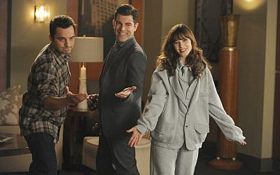 "Schmidt (Max Greenfield), center, Nick (Jake Johnson), left, and Jess (Zooey Deschanel) in a scene from ""New Girl,"" Feb. 3, 2015. (FOX via Getty Images / JTA)"